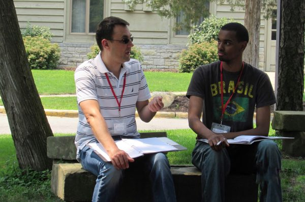 two students talking in courtyard